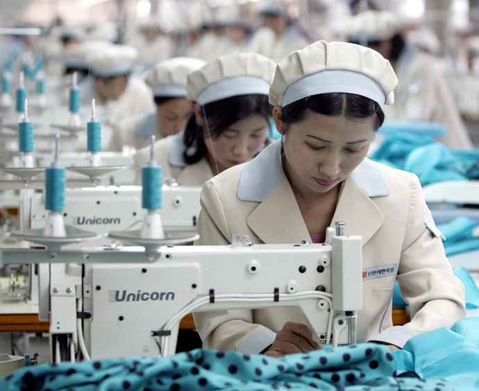 North Korean workers work at a factory of South Korean apparel maker Shinwon in the inter-Korean industrial park in Kaesong.