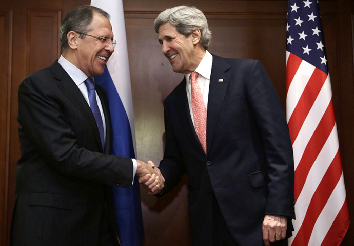 US Secretary of State John Kerry (R) and Russian foreign minister Sergei Lavrov shake hands at the beginning of their meeting in Berlin on February 26, 2013. (AFP Photo / Jacquelin Martin)