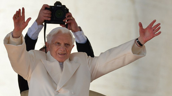 Pope Benedict XVI blesses faithful before leaving the altar at the end of his last weekly audience on February 27, 2013 at St Peter's square at the Vatican (AFP Photo / GabrielL Bouys)