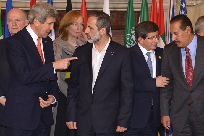 "US Secretary of State John Kerry, the Syrian opposition's National Coalition chief Ahmed Moaz al-Khatib, Turkey's foreign minister Ahmet Davutoglu and Qatari Prime Minister Sheikh Hamad bin Jassim al-Thani take place for the family photo of a meeting of the ""Friends of the Syrian People (FOSP) Ministerial"" group on February 28, 2013 in Rome. (AFP Photo / Alberto Pizzoli)"