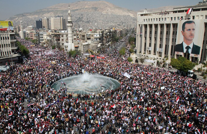 Thousands of Syrians rally to show their support for President Bashar al-Assad in Damascus on March 29, 2011. (AFP Photo / Anwar Amro)