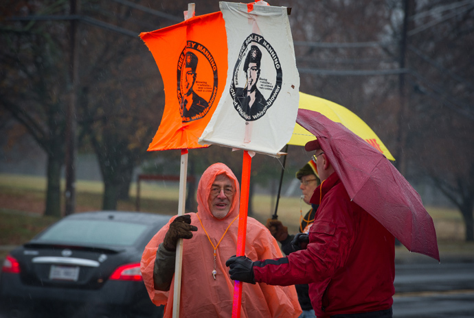 Members of the Bradley Manning Support Group protest under the rain during a rally at the entrance of Fort George G. Meade military base in Fort Meade, Maryland on November 27, 2012 (AFP Photo / Mladen Antonov)