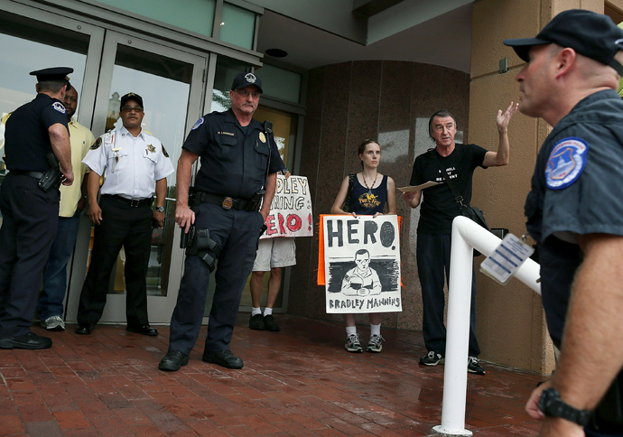 Police confront supporters of accused WikiLeaks whistleblower Bradley Manning during a protest in front of the Democratic National Committee headquarters, on September 6, 2012 in Washington, DC (Mark Wilson / Getty Images / AFP)