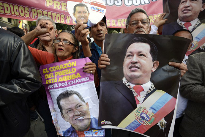Supporters of Venezuelan President Hugo Chavez gather at Simon Bolivar Square in Caracas. (AFP Photo / Juan Baretto)