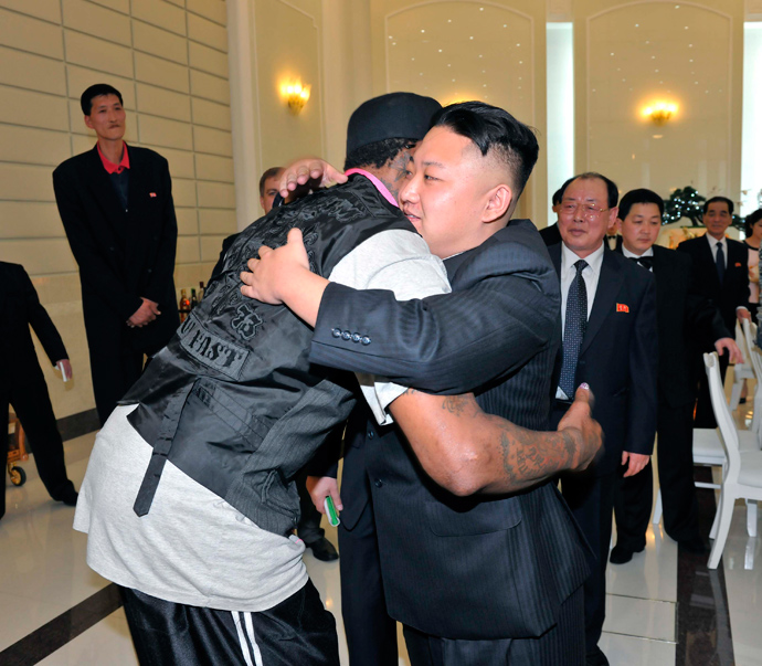 North Korean leader Kim Jong-Un and former NBA basketball player Dennis Rodman (front L) hug in Pyongyang on March 1, 2013 (Reuters / KCNA)