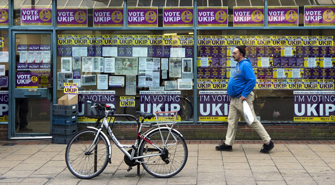 A man walks past the British UK Independence Party (UKIP) office in Eastleigh, southern England, on February 25, 2013. (AFP Photo / Adrian Dennis)