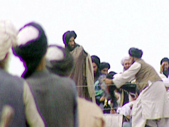 TV grabs taken secretly by BBC Newsnight shows Taliban's one-eyed spiritual leader Mullah Mohammed Omar (C) during a rally of his troops in Kandahar before their victorious assault on Kabul in 1996. (AFP Photo / BBC News)