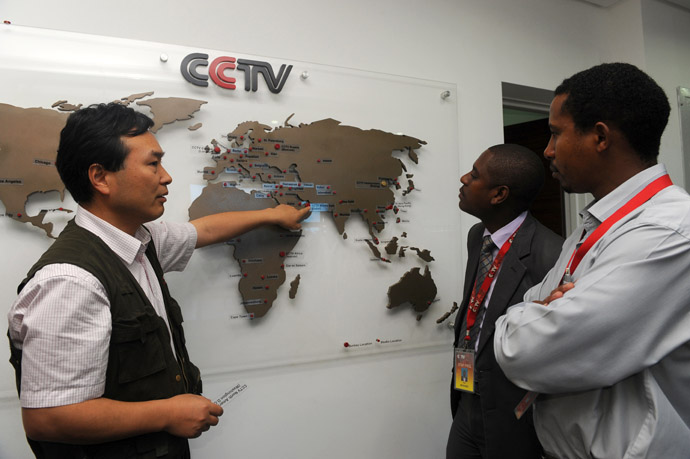 This picture taken on June 12, 2012 shows the managing editor of China Central Television (CCTV) Africa Pang Xinhua (L) talking to local journalist as he shows them how the organization has expanded in different parts of Africa, in the premises of the television in Nairobi. (AFP Photo/Simon Maina)