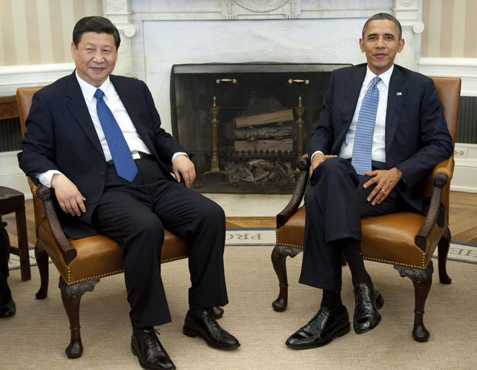 Barack Obama and Xi Jinping speak during meetings in the Oval Office of the White House in Washington, DC, February 14, 2012.  (AFP Photo/Saul Loeb)