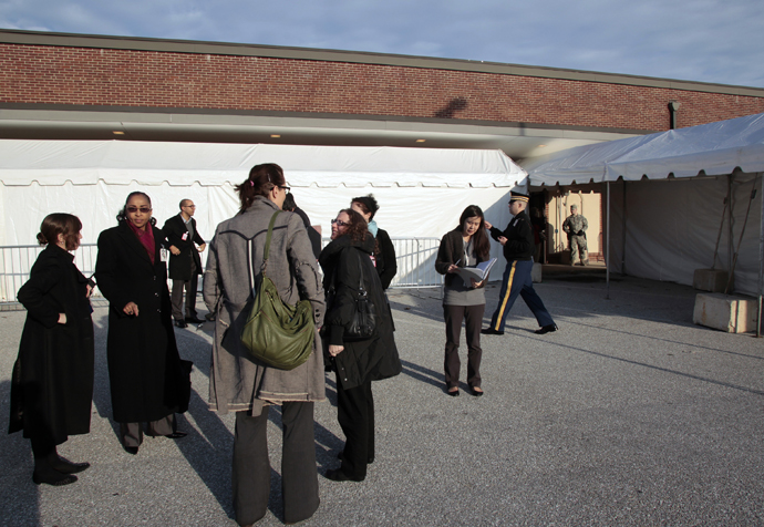 Journalists stand outside the courthouse at Fort Meade, Maryland during the US vs Private Bradley E. Manning Article 32 hearing December 16, 2011. (Reuters / Yuri Gripas)