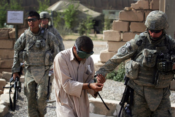 An Iraqi man detained by US forces for alleged links to al-Qaeda. (AFP Photo / David Furst)