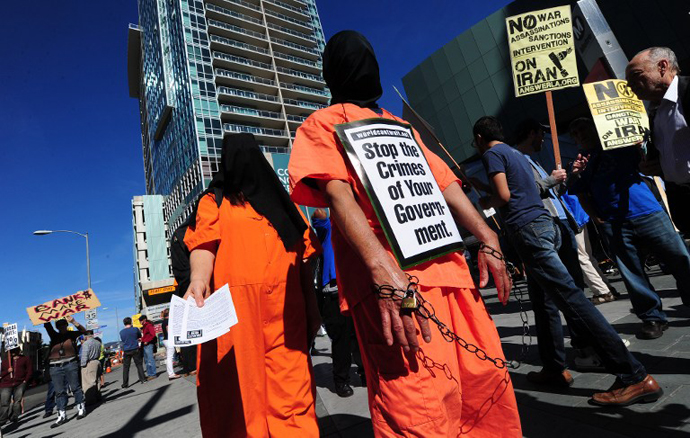 "Demonstrators dressed as a Guantanamo Bay prisoners attend a ""No War on Iran"" protest in Los Angeles, California, on February 4, 2012. (AFP Photo / Frederic J. Brown)"