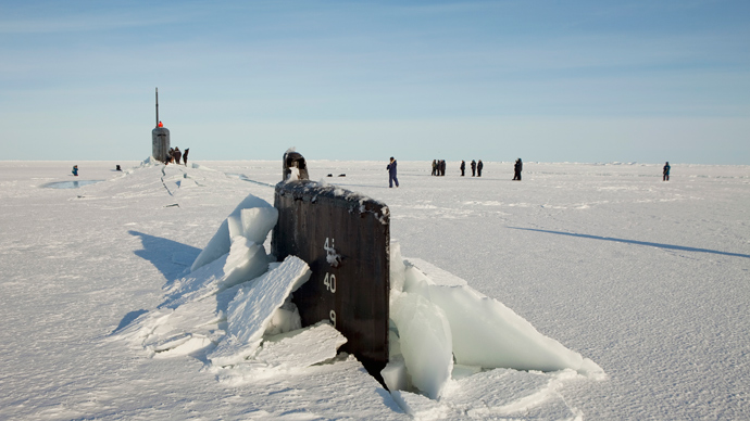 A congressional delegation and the Secretary of the Navy walk around the Seawolf class submarine USS Connecticut after the boat surfaced through through Arctic sea ice during an exercise near the 2011 Applied Physics Laboratory Ice Station north of Prudhoe Bay, Alaska March 18, 2011 (Reuters / Lucas Jackson)