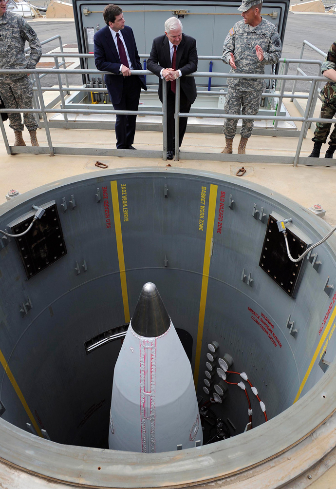 U.S. Sen. Mark Begich (D-AK), and U.S. Secretary of Defense Robert Gates (C), listen to a brief on a ground-based interceptor missile silo on Fort Greeley, Alaska, June 1, 2009 (Reuters / Jerry Morrison)
