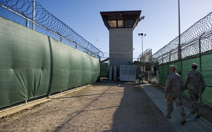 "This image reviewed by the US military, show two members of the military walking out of the ""Camp Six"" detention facility of the Joint Detention Group at the US Naval Station in Guantanamo Bay, Cuba, January 19, 2012. (AFP Photo/Jim Watson)"
