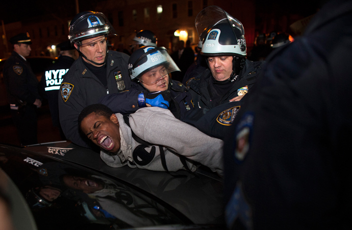 "NYPD officers arrest a young man during a protest against the killing of 16-year-old Kimani ""Kiki"" Gray who was killed in a shooting involving the NYPD, in the Brooklyn borough of New York March 13, 2013 (Reuters / Eduardo Munoz)"