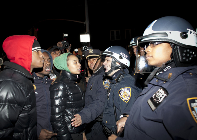 Demonstrators faceoff against police during a protest against the shooting of Kimani Gray, March 13, 2013 in the East Flatbush neighborhood of the Brooklyn borough of New York City (Allison Joyce / Getty Images / AFP)