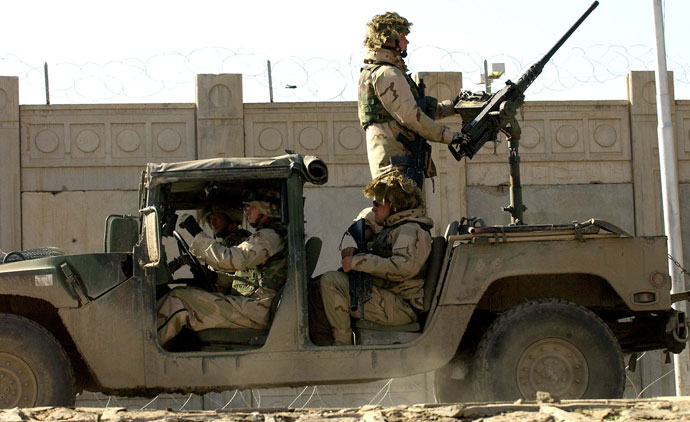 US soldiers from the 1st Battalion, 22nd Regiment of the 4th Infantry Division, ride on a military vehicle as they leave their base on a mission in Tikrit, 180 Kilometers (110 miles) north of Iraqi capital Baghdad.(AFP Photo / Jewel Samad)