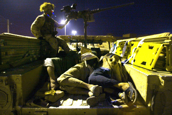 Three Iraqi detainees await inside a Humvee military vehicle during a raid in the area by US troops, on outskirts of Tikrit, 180 kms (110 miles) north of Iraq's capital Baghdad.(AFP Photo / Mauricio Lima)