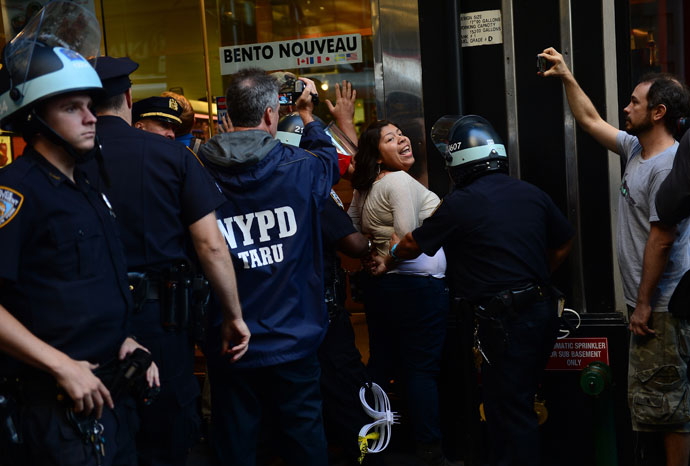 A participant in Occupy Wall Street protest is arrested by police during a rally to mark the one year anniversary of the movement in New York.(AFP Photo / Emmanuel Dunand )