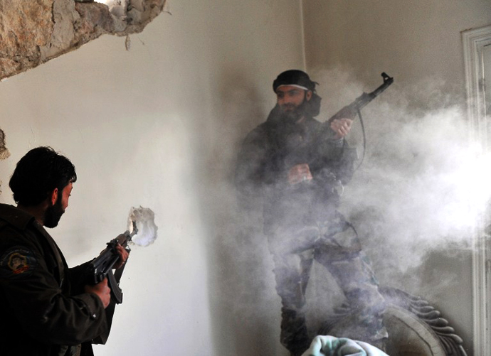 Rebels clash with Syrian government forces at Saif al-Dawla district in the northern Syrian city of Aleppo on March 23, 2013. (AFP Photo / Bulent Kilic)