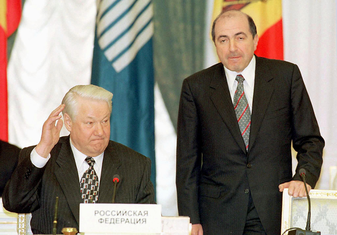 A file picture dated 29 April 1998 in Moscow shows Russian President Boris Yeltsin (L) as he votes for the candidacy of Boris Berezovsky (R) for the post of executive secretary of the Commonwealth of Independent States (CIS) (AFP Photo)