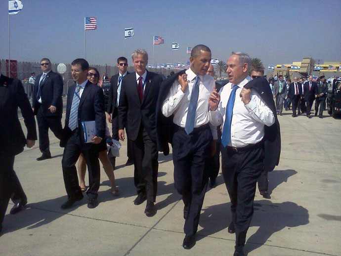 "Obama and Netanyahu on the Ben Gurion tarmac. ""Tweeters pointed out that when Obama took his jacket off, Netanyahu promptly mimicked the president. Everything seems well coordinated.""(Photo from twitter.com user @netanyahu)"