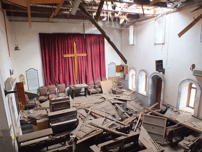 Damages are seen inside a church in the city of Homs.(Reuters / Yazan Homsy)