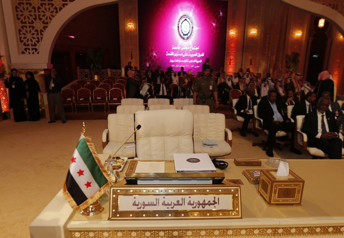 A pre-Baath Syrian flag, currently used by the Syrian opposition, is seen in front of the seat of the Syrian delegation at the opening of the Arab League summit in the Qatari capital Doha on March 26, 2013. (AFP Photo / Karim Sahib)