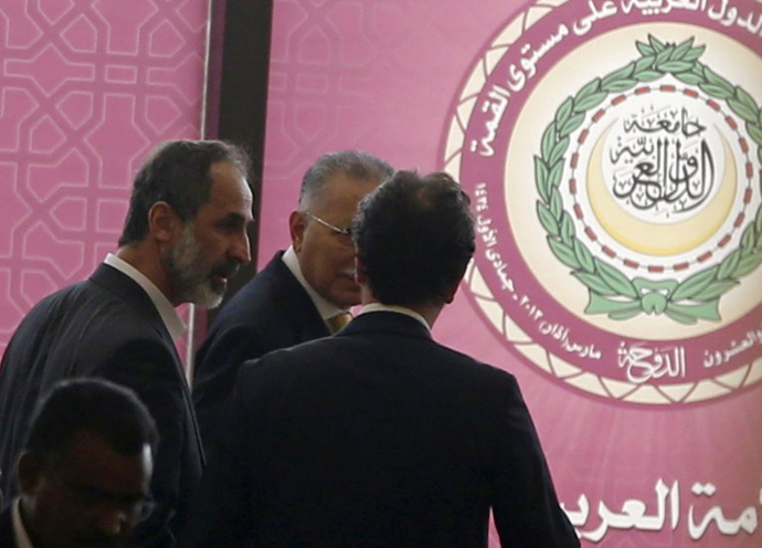 Ahmed Moaz al-Khatib (L), head of the Syrian opposition delegation attends the opening of the Arab League summit in the Qatari capital, Doha, on March 26, 2013. (AFP Photo / Karim Sahib)