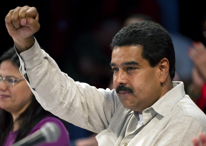 Venezuelan acting president Nicolas Maduro raises his clenched fist during a rally with leftist political parties in Caracas on March 20, 2013. (AFP Photo)