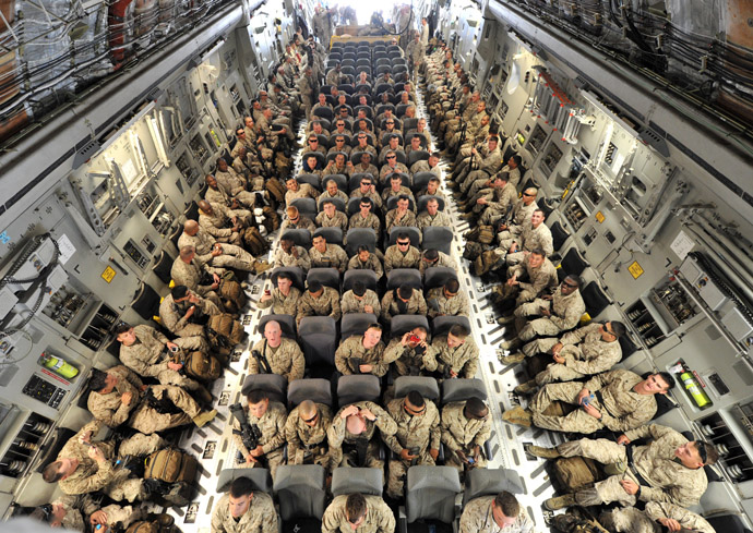 US servicemen inside of a plane before their departure to Afghanistan from the US transit center Manas, 30 km outside the Kyrgyzstan's capital Bishkek, on March 27, 2012. (AFP Photo)