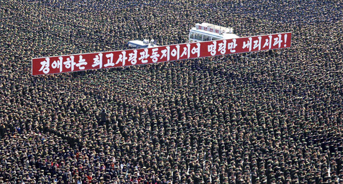 This photo taken and released by North Korea's official Korean Central News Agency (KCNA) on March 29, 2013 shows a gathering at Kim Il Sung Square in Pyongyang to support the statement of the Supreme Command of the North Korean Army and to win victory in the battle with the US and South Korea. (AFP Photo/KCNA via KNS)