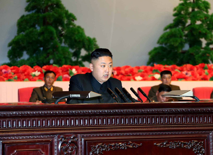 his photo taken on March 28, 2013 and released by North Korea's official Korean Central News Agency (KCNA) on March 29, 2013 shows North Korean leader Kim Jong-Un (C) making a speech during the meeting of information workers of the whole army in Pyongyang. (AFP Photo/KCNA via KNS)