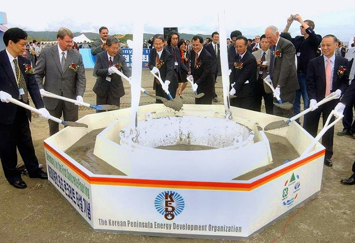 This file photo dated 07 August 2002 shows officials of the Korean Peninsula Energy Development Organization placing the first concrete in the foundation for a nuclear reactor in the Light Water Reactor project, being built under the so-called Agreed Framework signed by Pyongyang and Washington in 1994, at Kumho in North Korea's northeastern coastal. (AFP Photo)