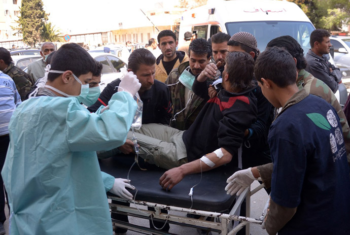 In this image made available by the Syrian News Agency (SANA) on March 19, 2013, a man is brought to a hospital in the Khan al-Assal region in the northern Aleppo province, as Syria's government accused rebel forces of using chemical weapons for the first time. (AFP Photo)