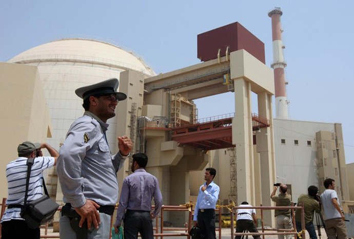 An Iranian security man stands next to journalists outside the Bushehr nuclear power plant in southern Iran. The Stuxnet computer worm has infected 30,000 computers in Iran but has failed to cause serious damage, Iranian officials were quoted as saying on September 26, 2010. (AFP Photo / Atta Kenare)