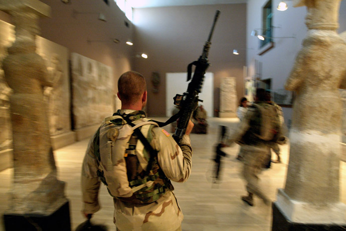 Two US soldiers from the 1st Division, 2nd Bridage, Texas, visit the Iraq Museum 10 September 2003 in Baghdad. (AFP Photo)