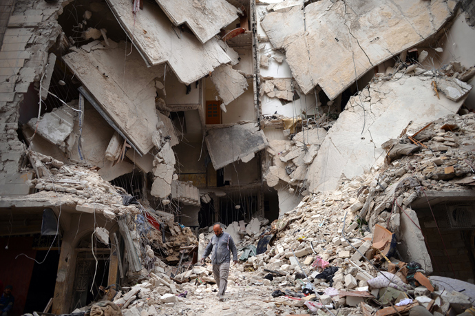 A Syrian man walks amid destruction in the northern Syrian city of Aleppo on April 10, 2013 (AFP Photo / Dimitar Dilkoff)