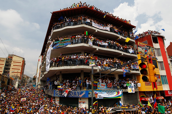 Supporters of Venezuela's opposition leader and presidential candidate Henrique Capriles attend a campaign rally in the state of Merida April 10, 2013 (Reuters / Carlos Garcia Rawlins)