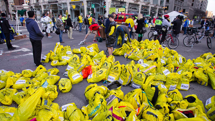 Volunteers organize participants for belongings for collection after two explosions interrupted the running of the Boston Marathon in Boston, Massachusetts April 15, 2013 (Reuters / Dominick Reuter)