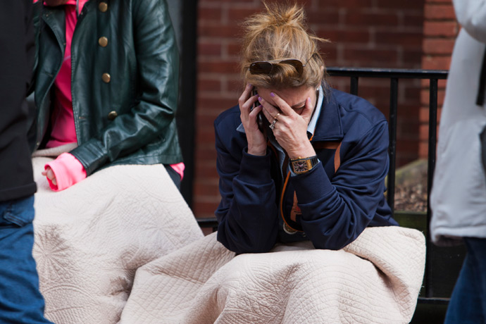 A woman talks on the phone after two explosions interrupted the running of the Boston Marathon in Boston, Massachusetts April 15, 2013 (Reuters / Dominick Reuter)