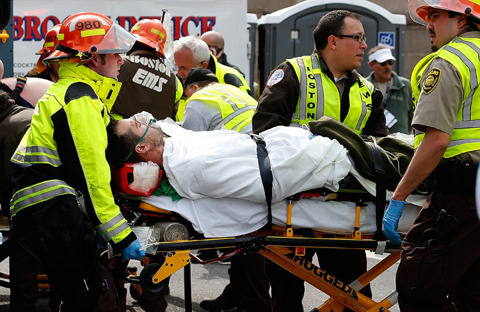 A man is loaded into an ambulance after he was injured by one of two bombs exploded during the 117th Boston Marathon near Copley Square on April 15, 2013 in Boston, Massachusetts (AFP Photo / Jim Rogash)