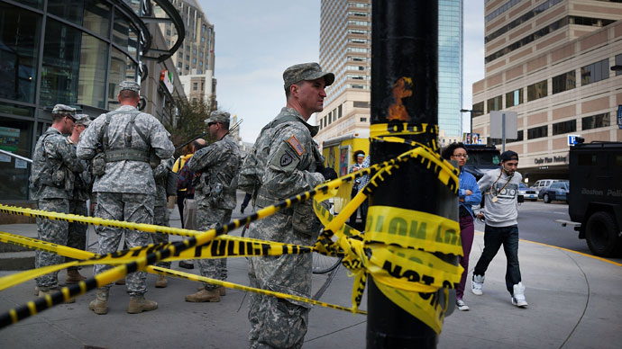 National Guard soldiers guard a roadblock near the scene of yesterday's bombing attack at the Boston Marathon on April 16, 2013 in Boston.(AFP Photo / Spencer Platt)