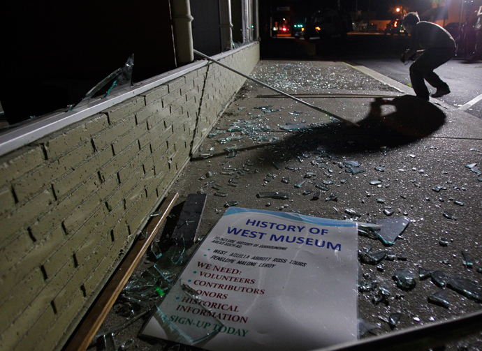 A sign rests on a sidewalk amid shattered glass after an explosion at a fertilizer plant in the town of West, near Waco, Texas early April 18, 2013 (Reuters / Mike Stone)
