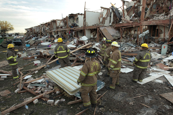 alley Mills Fire Department personnel walk among the remains of an apartment complex next to the fertilizer plant that exploded yesterday afternoon on April 18, 2013 in West, Texas. (Erich Schlegel/Getty Images/AFP)