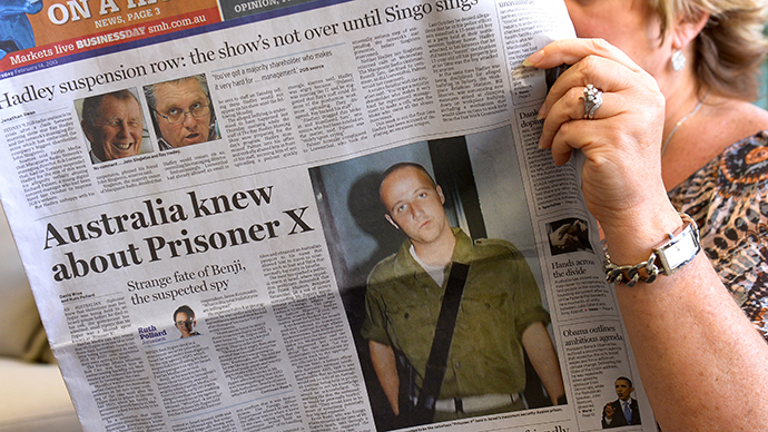 A woman poses with an Australian newspaper showing the front page story of Ben Zygier, as Israel confirms it jailed a foreigner in solitary confinement on security grounds who later committed suicide, with Australia admitting it knew one of its citizens had been detained. (AFP Photo / William West)