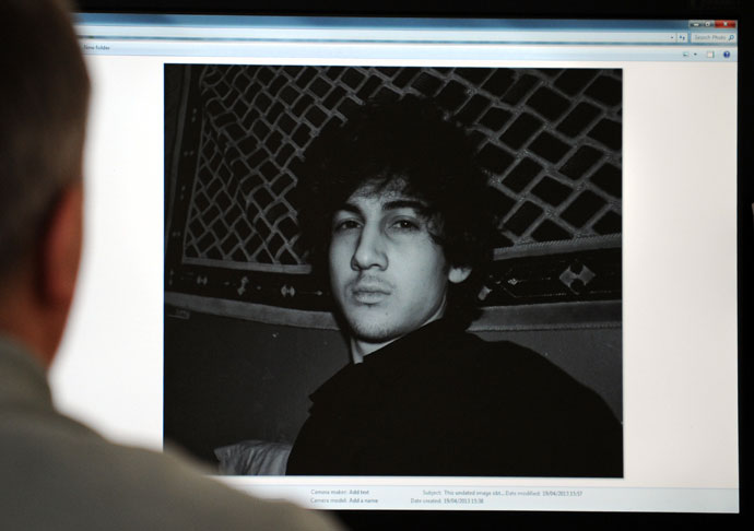 A man looks in Moscow on April 19, 2013, at a computer screen displaying an undated picture the 19-year-old Dzhokhar Tsarnaev posted on his is page in VKontakte, a Russian social media site. Dzhokhar Tsarnaev is the subject of a April 19, 2013.(AFP Photo)