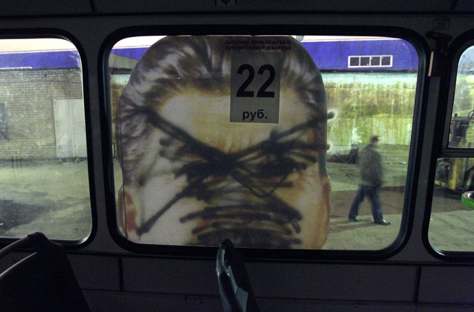 A defaced portrait of former Soviet dictator Josef Stalin is seen on a bus in St.Petersburg May 5, 2010. (Reuters)