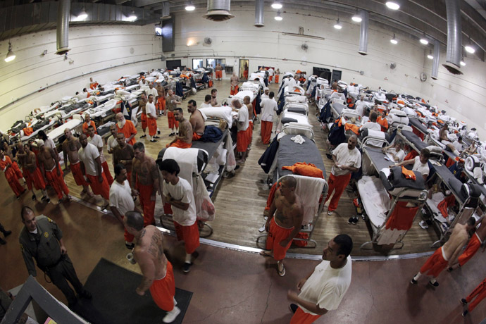 Inmates walk around a gymnasium where they are housed due to overcrowding at the California Institution for Men state prison in Chino, California, June 3, 2011. (Reuters/Lucy Nicholson)